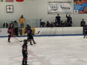Jacob and his team celebrating after his first ever hockey goal- he scored twice!